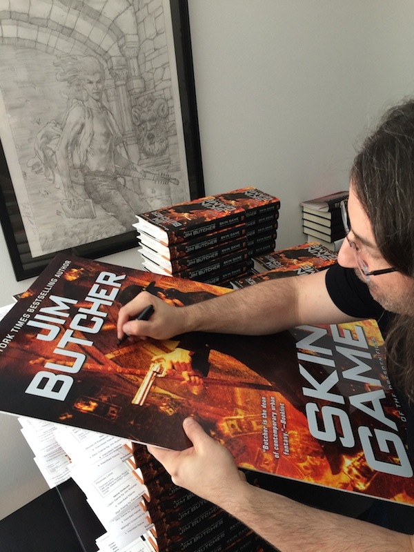 Jim signing the poster!